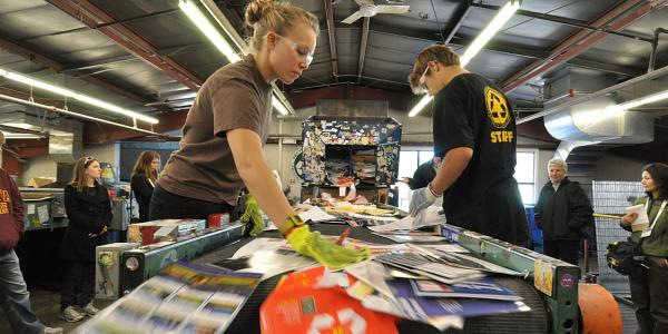 Students work in the campus recycling center