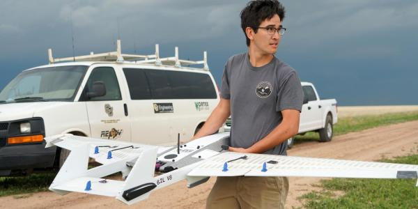 Student with a drone in the field