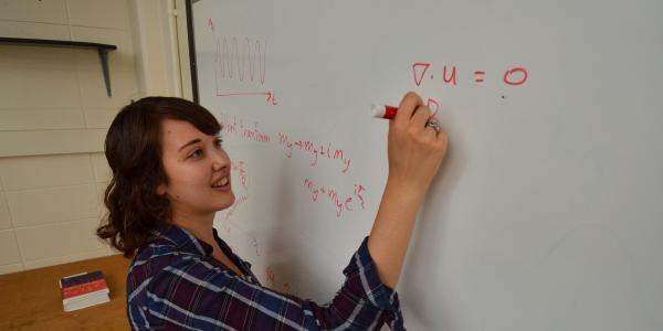 student doing problem on white board