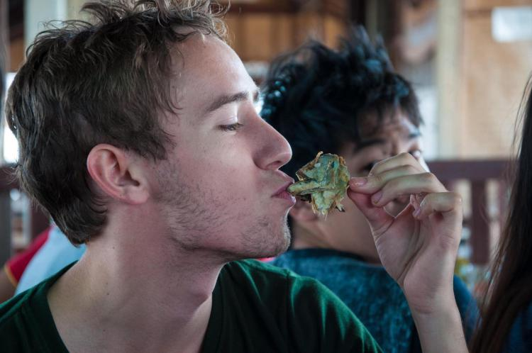 Ross Fischer eats exotic food during study abroad