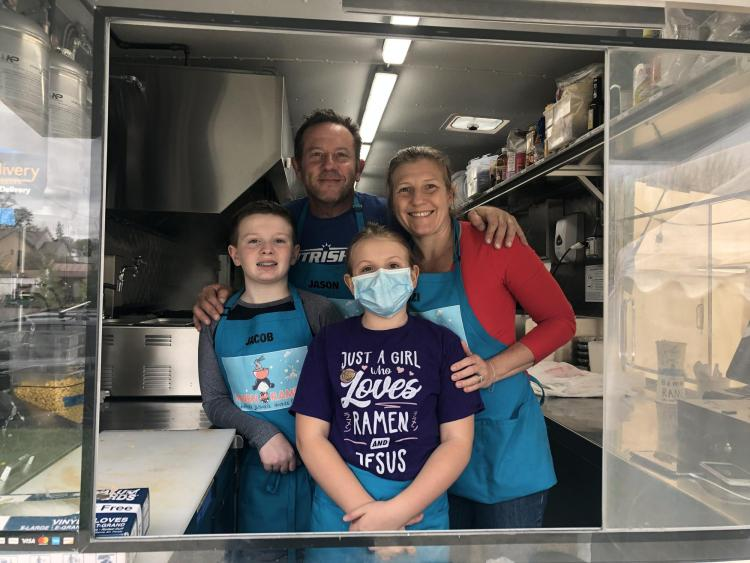 Jewett family prepares to serve from the Bamen Ramen food truck