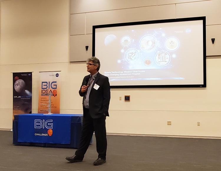 Calomino giving a presentation for NASA
