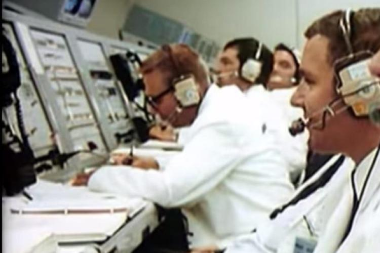 Woodward, far left, leaning over the LH2 Panel writing fuel loading times.
