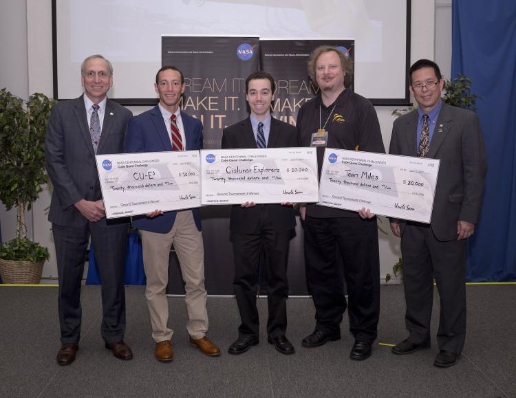 The check presentation to the three winning teams