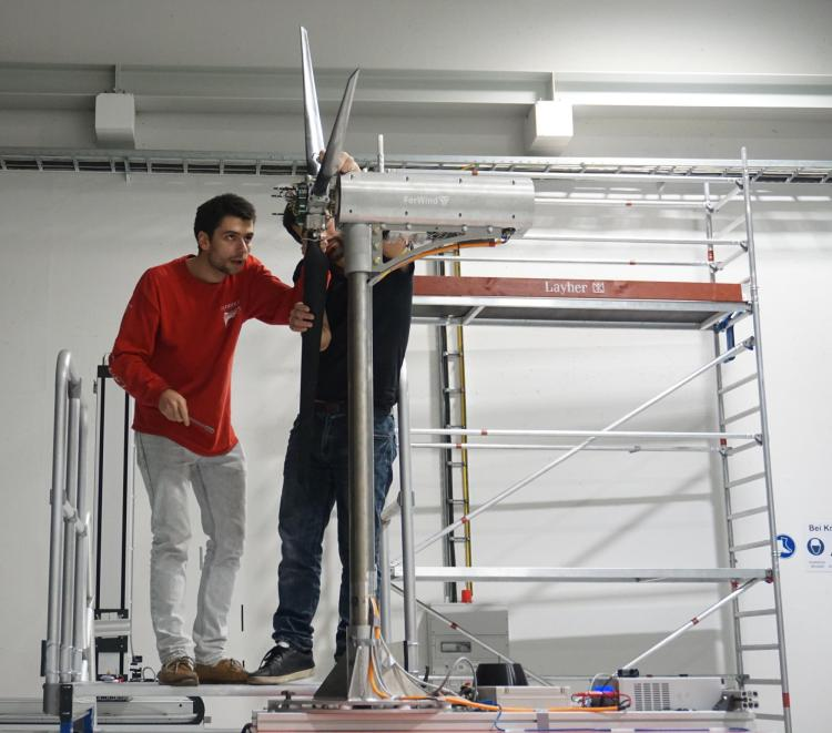 Misha and another researcher working on the turbine