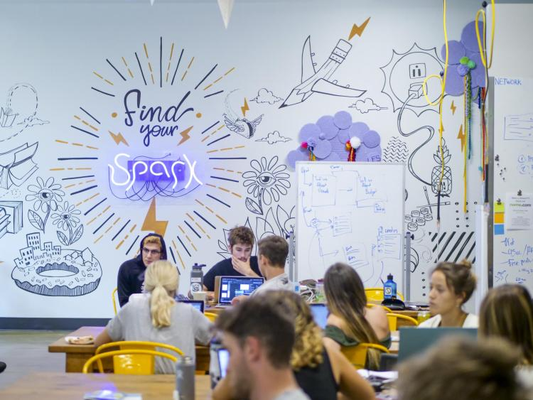 Students work at Innovation Station in Williams Village in summer 2019