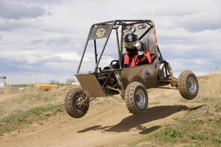 The vehicle getting air on a course.