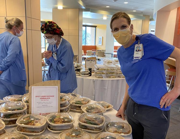 Medical staff at Boulder Community Health pick up meals.