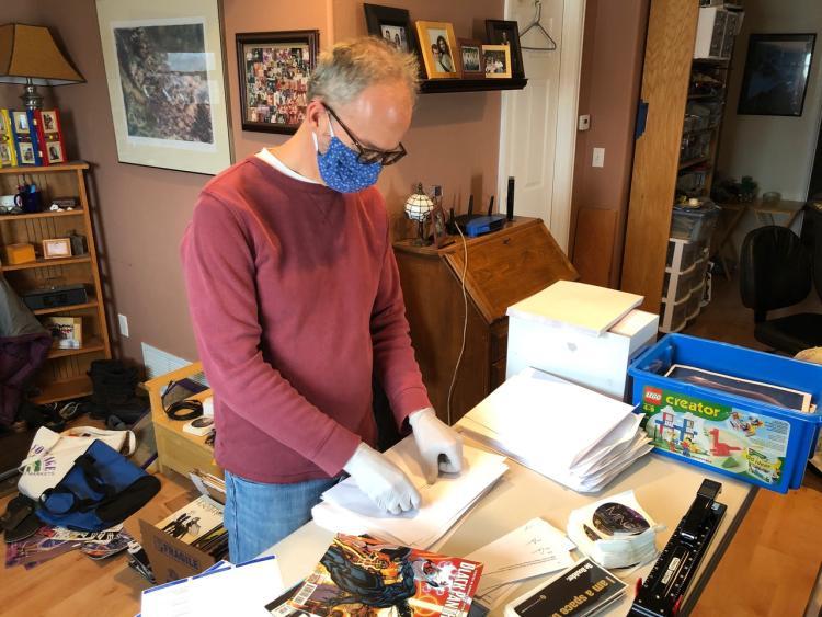 Chris Koehler assembles care packages