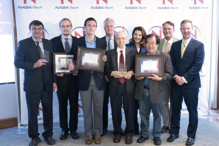 Representatives from each of the three finalist teams. CU Boulder professor Ivan Smalyukh and PhD student Andrew Hess are on the far left.