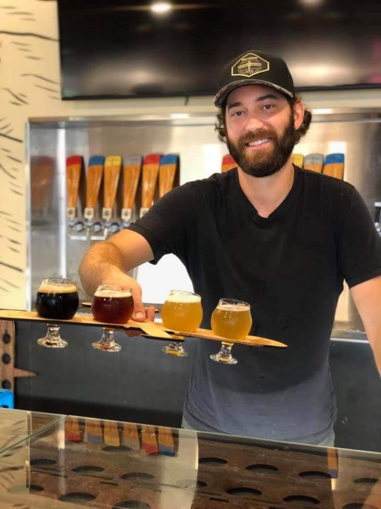 Jason Slingsby serves beer at FlyteCo