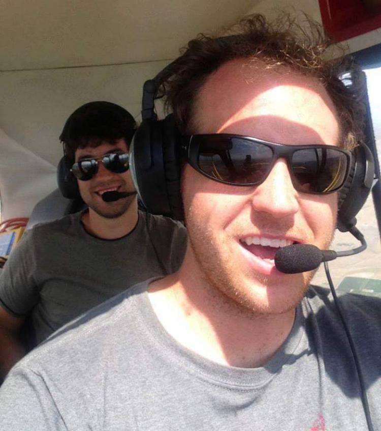 Jason Slingsby and Eric Serani in the cockpit of a small plane