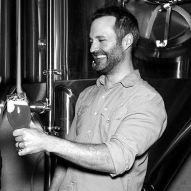 Jason zumBrunnen pouring beer from barrel