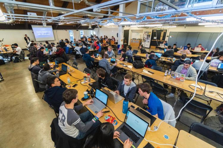 Students work on projects in the Idea Forge during Local Hack Day.