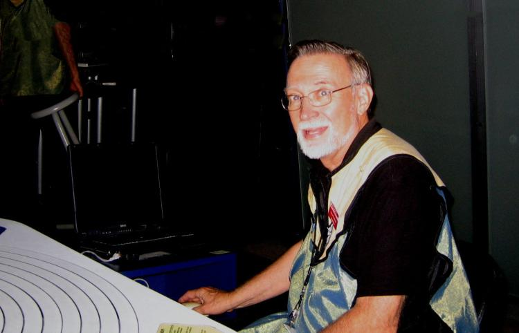 Stewart Woodward volunteering at the Denver Museum of Nature and Science teaching astronomy and aerospace.