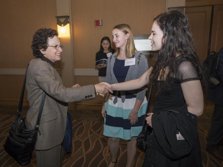 Jill Tietjen (left) meets scholarship recipients at the college's 2017 scholarship dinner.