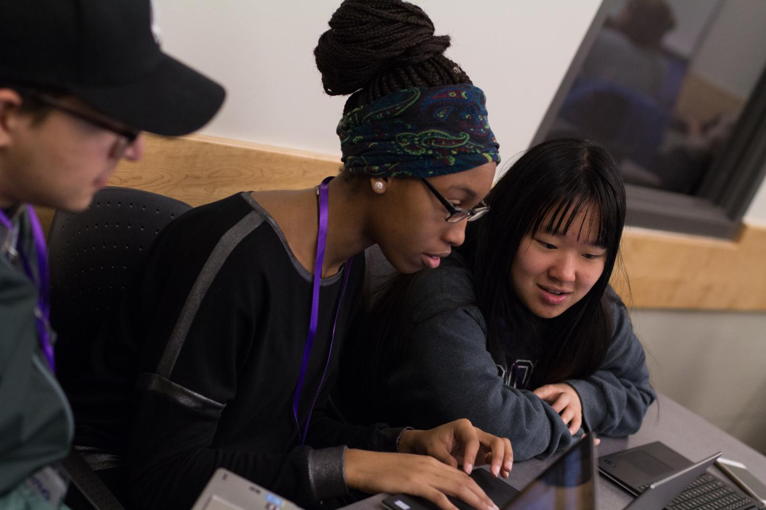 Women coding at the T9 Hacks event