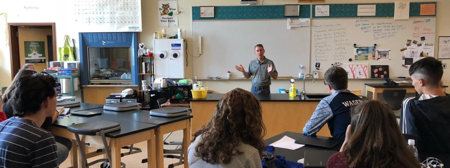 Bobby Braun leads a discussion about engineering in a classroom at Akron High School.