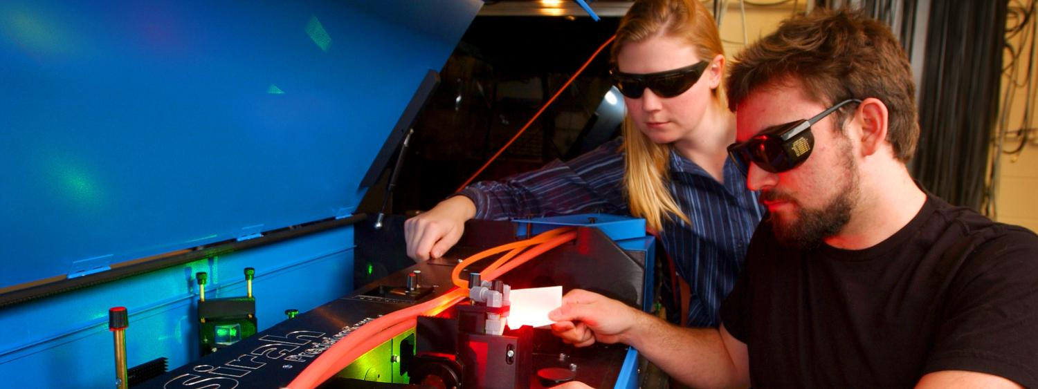 students working with laser