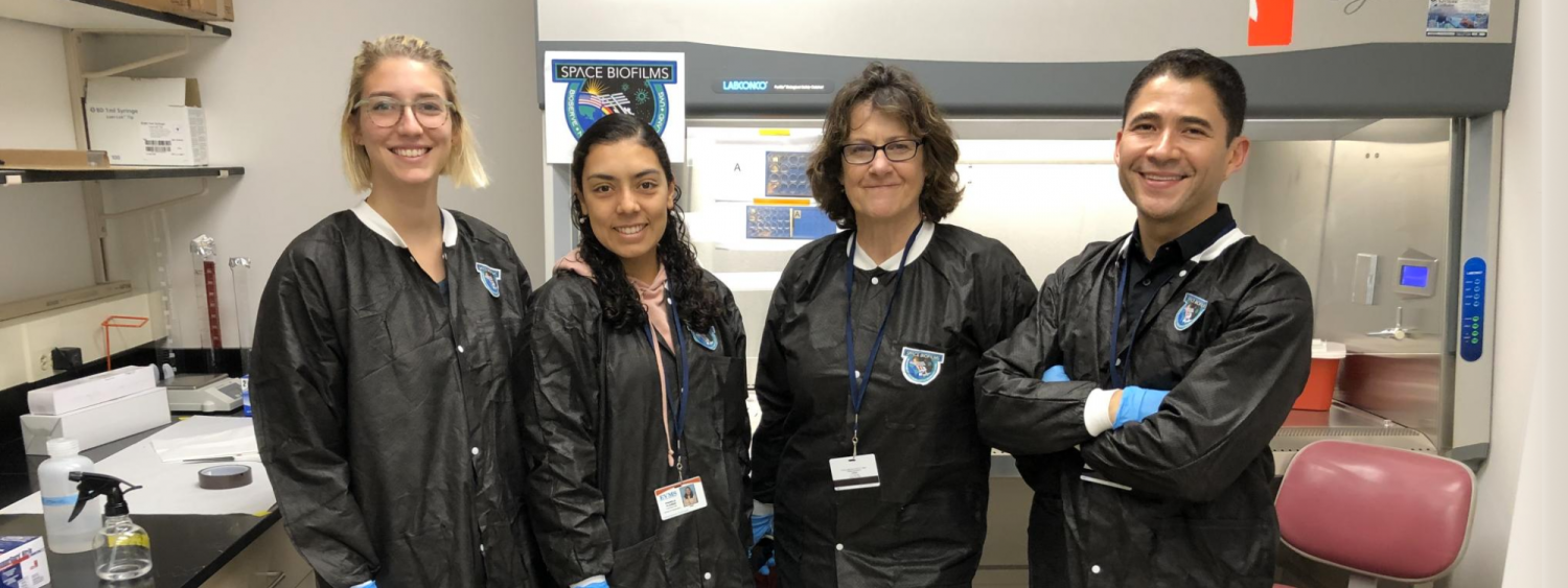 Graduate students Rylee Schauer and Pamela Flores with Carla Hoehn, BioServe's implementation project manager and Principal Investigator Luis Zea.