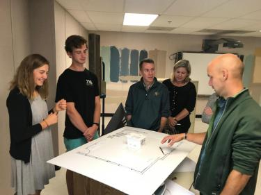 Bobby and Karen Braun tour Animas High School's Maker Space with students and an engineering instructor.