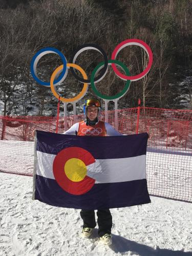 JT Abate holding Colorado flag at Olympics