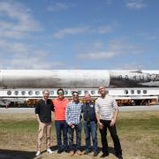 Members of the science and implementation team at Kennedy Space Center with a space-proven Falcon 9 rocket on the background. From left to right: Eric Yarns (KU), Kevin Ngo (KU), Luis Zea (CU), Dr. Joe Tash (KU), and Sam Piper (CU)