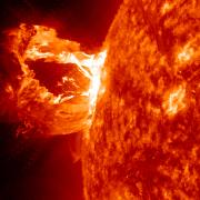 An eruption captured here by NASA's Solar Dynamics Observatory in the 304 Angstrom wavelength, which is typically colored in red.