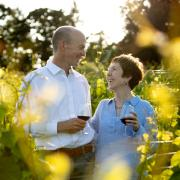 Kevin Green and wife Clodagh drinking wine in a vineyard
