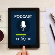 An Ipad playing a podcast