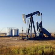 Oil well and storage tanks in a field