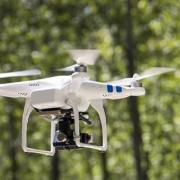 A drone flying in the woods