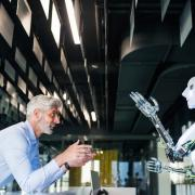 A man and a robot talking to each other