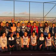 Dave Clough with members of the AIUS women's basketball team