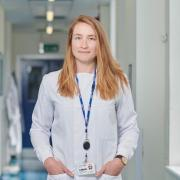 Anna Blakney in lab coat at Imperial College London