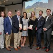 The three Global Engineering Award winners pose with Mortenson Center staff and the college's dean, Bobby Braun.