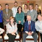 Alice and Mort Mortenson (seated), with staff and graduate students of the Mortenson Center in Global Engineering, including former managing director Robyn Sandekian and founding director Bernard Amadei (standing, second and third from left).