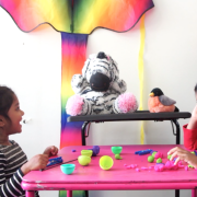 Two children chat with the MindScribe stuffed zebra.