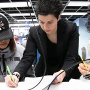 Dimitra Psychogiou works with two students in the ECEE circuits lab.