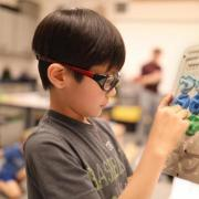Jaejune Lee plays with a prototype of the Rain Game. (Credit: Jade Cody/Boulder Valley School District)