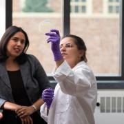 Chatterjee working in the lab with a student