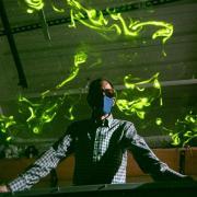 John Crimaldi watches as green laser light illuminates plumes in his lab's test flume.
