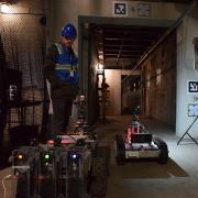 Students working in the tunnels with the drones.