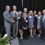Lisa Hardaway's family accepts her Engineer of Distinction Award during the Engineering Alumni Awards Banquet.