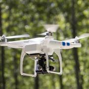 Drone flying in woods