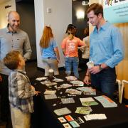 """Children ask questions about EdBoard during the Demo Days """"petting zoo."""""""