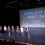 Students on stage at Catalyze Demo Day in 2018.