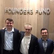 Students participating in Starts H4D stand together at Founders Fund sign