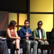 Panelists on stage.