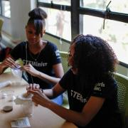 Two Girls Inc. Eureka! students in the midst of testing their water filters